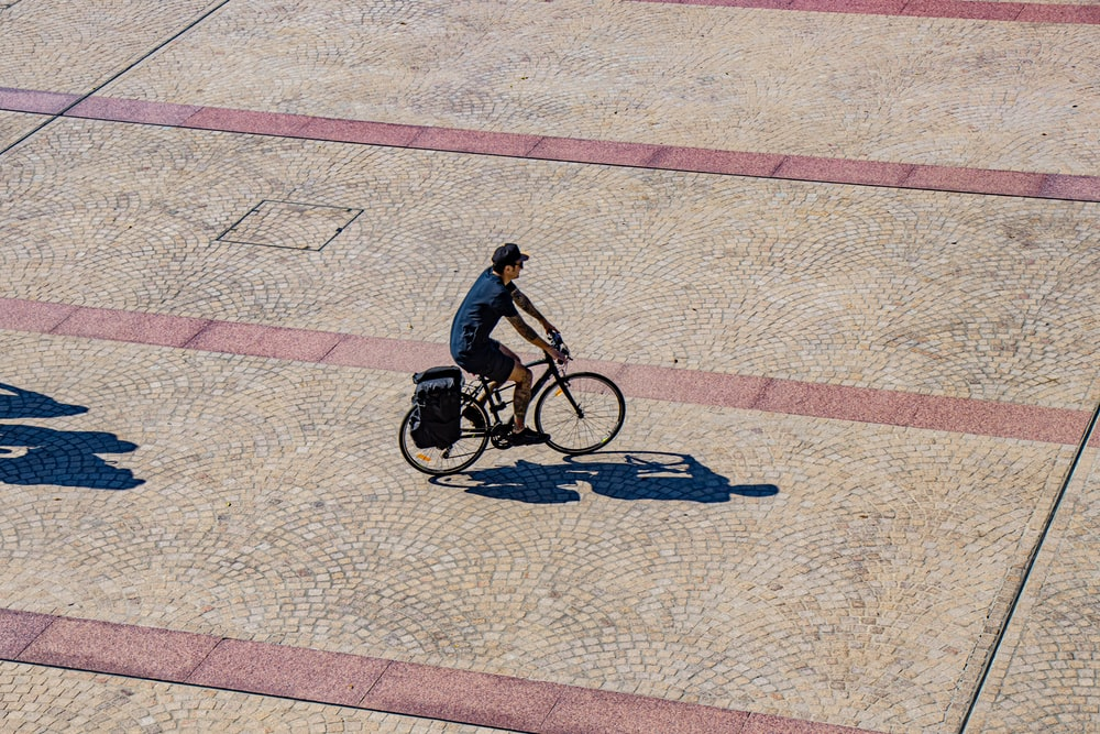 person riding city bike during daytime