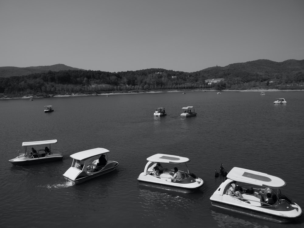 boats on body of water during day