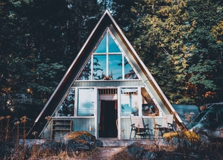 view photography of triangular house in forest
