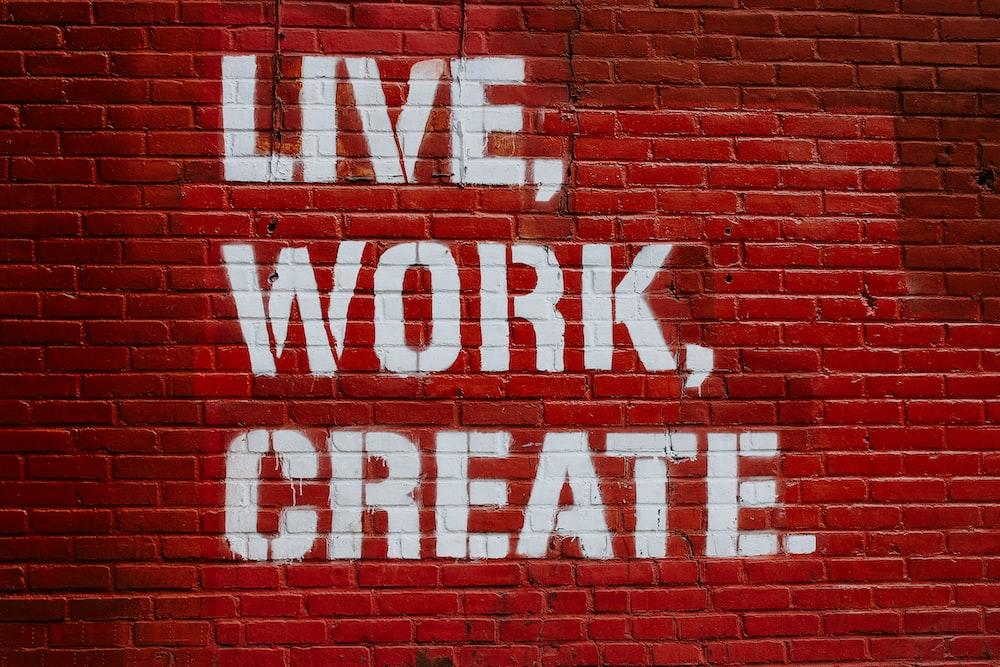 Live, Work, Create. graffiti on brick wall