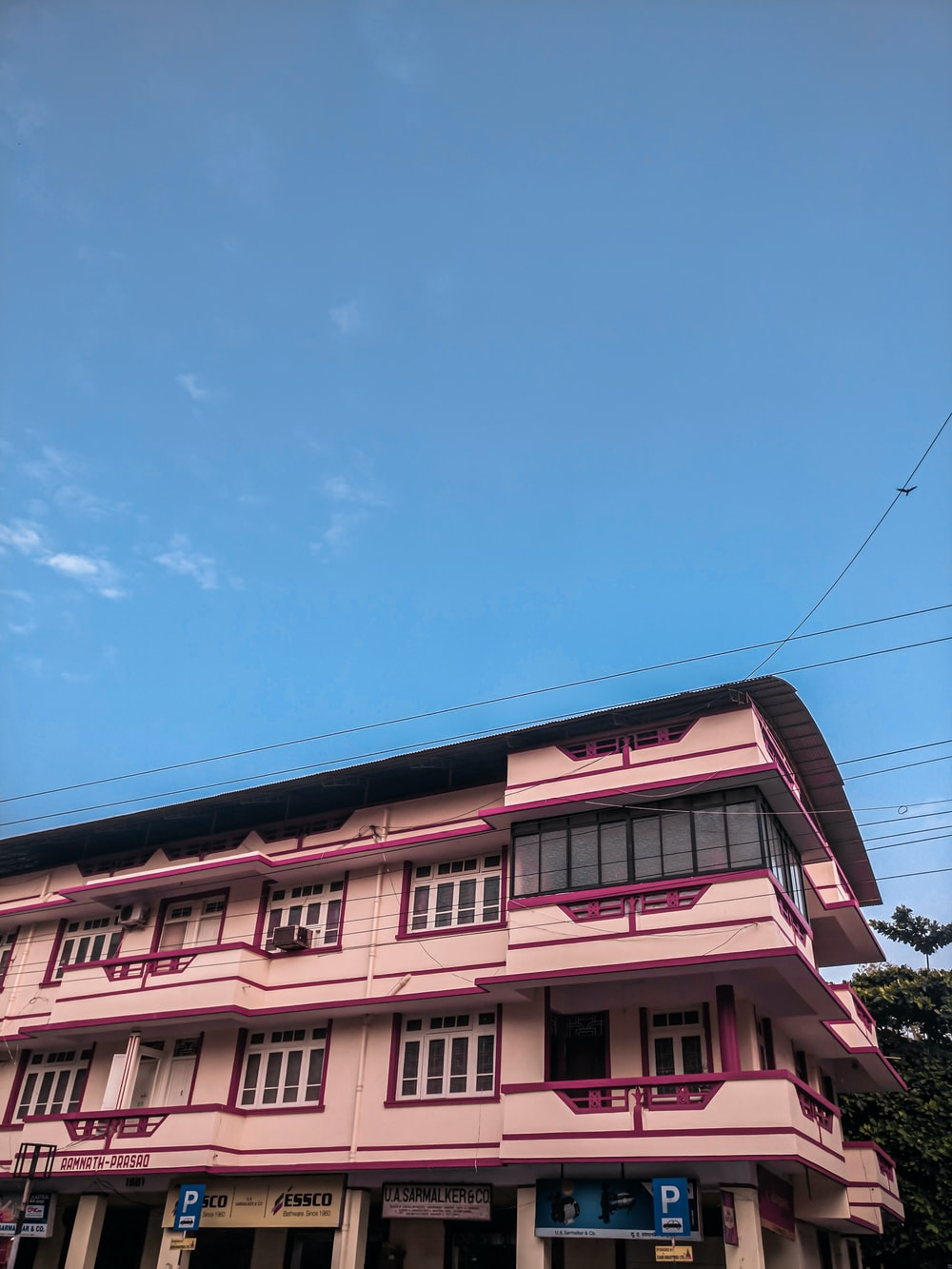 pink building under blue and white sky