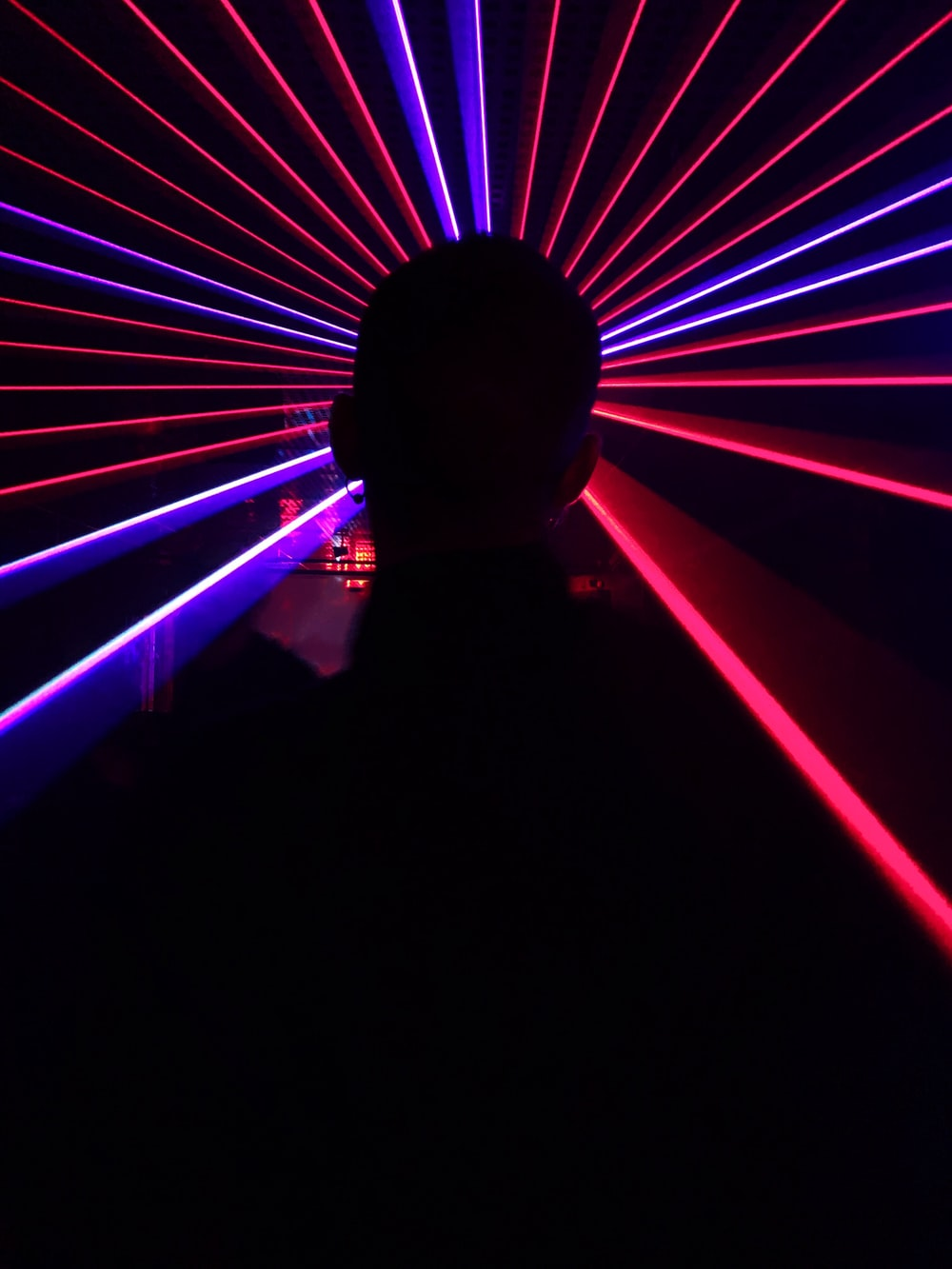silhouette of people showing red LED lights