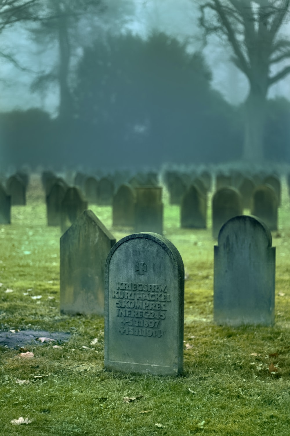 gray tombstones during daytime