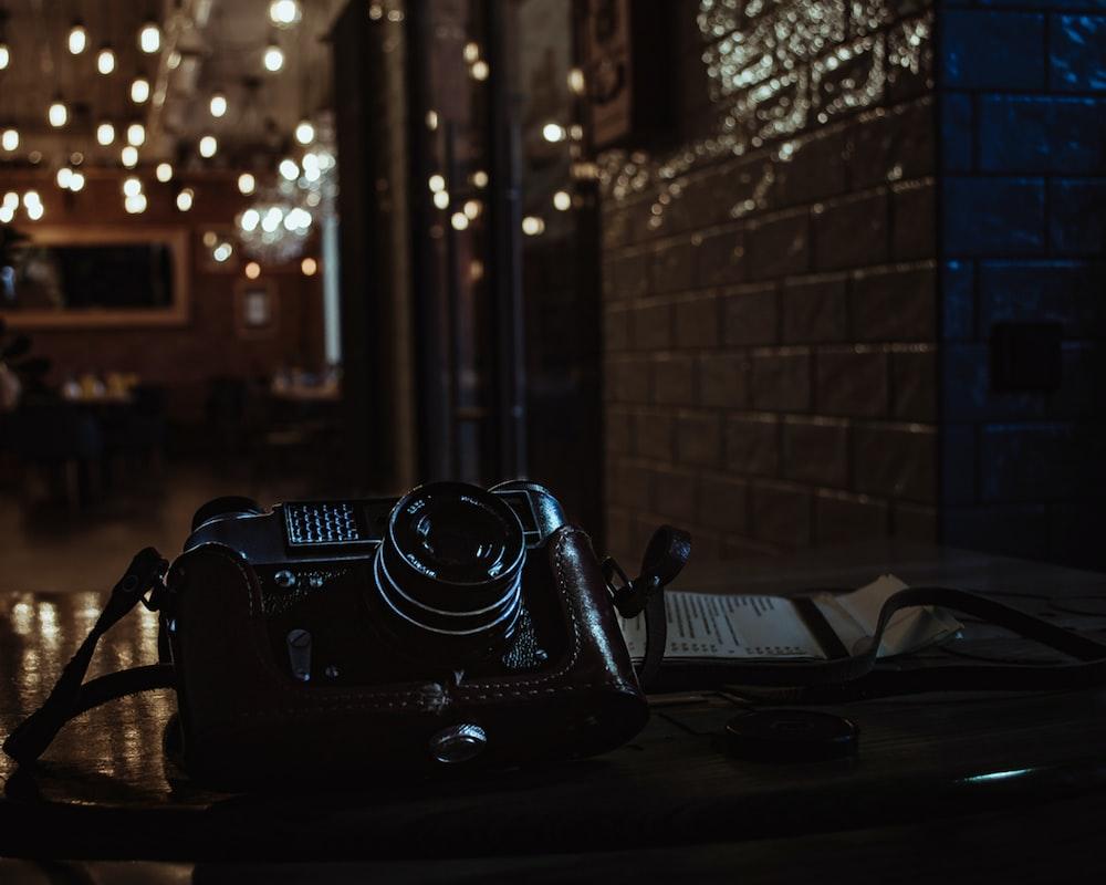 shallow focus photo of black SLR camera