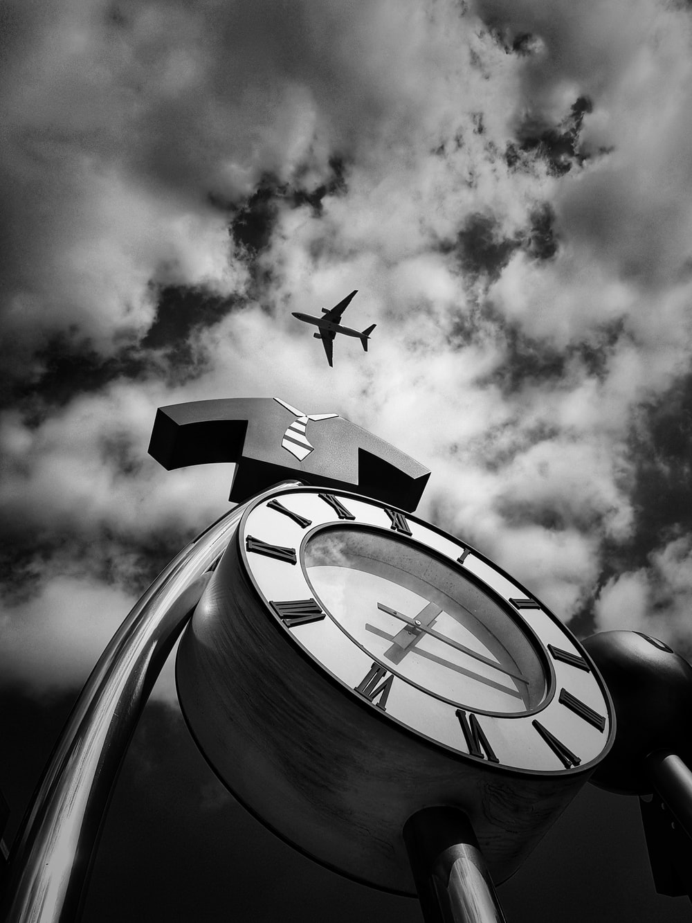 grayscale photo of flying airplane