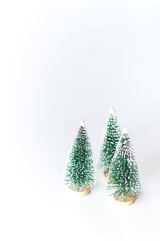 three small green Christmas trees