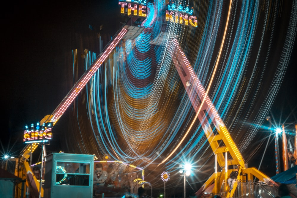 time-lapse photography of roller coaster ride during night time