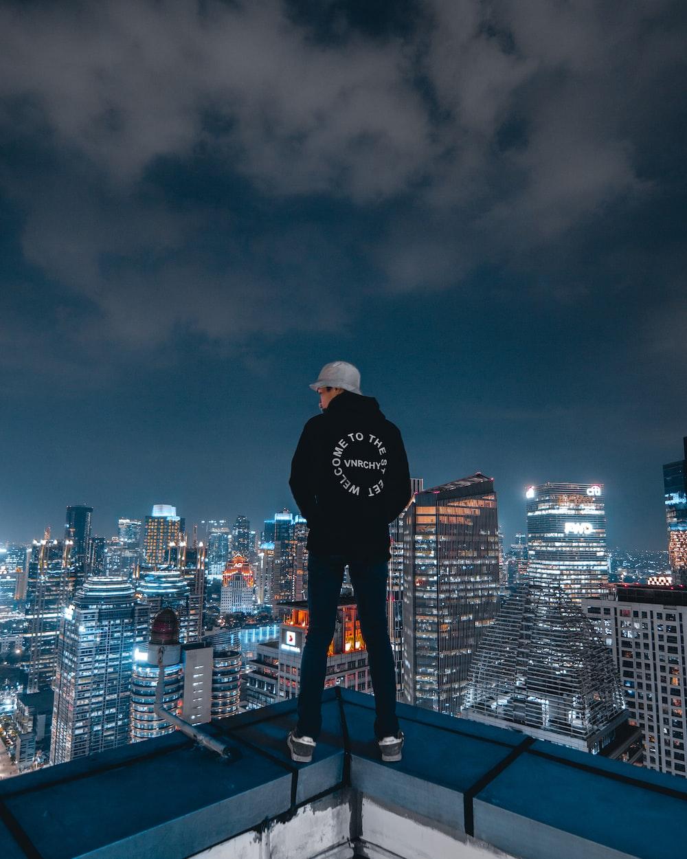 man wearing black pullover hoodie and pants
