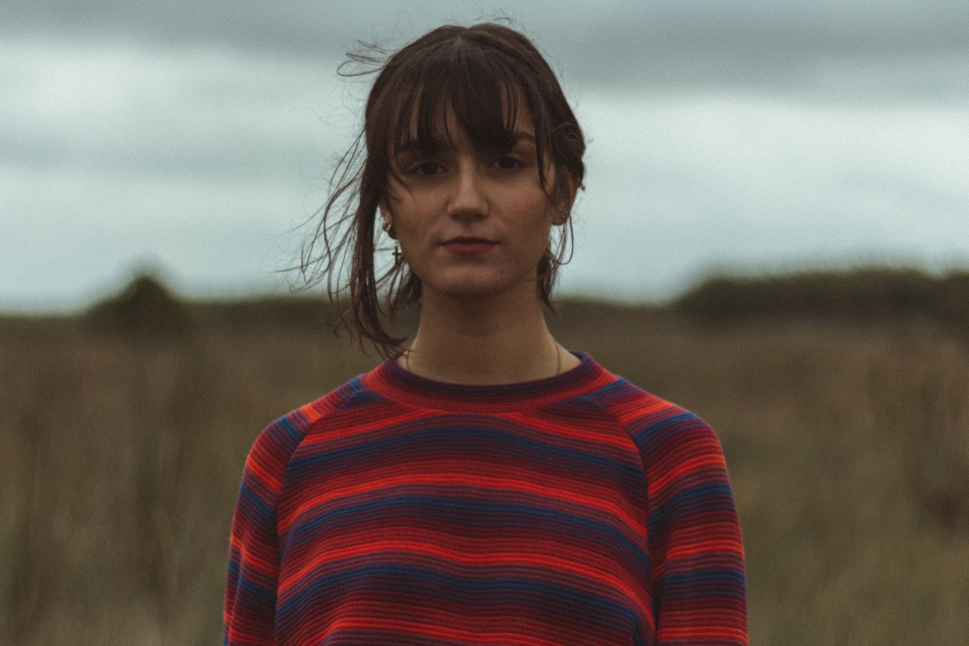 woman wearing blue and red striped crew-neck long-sleeved shirt