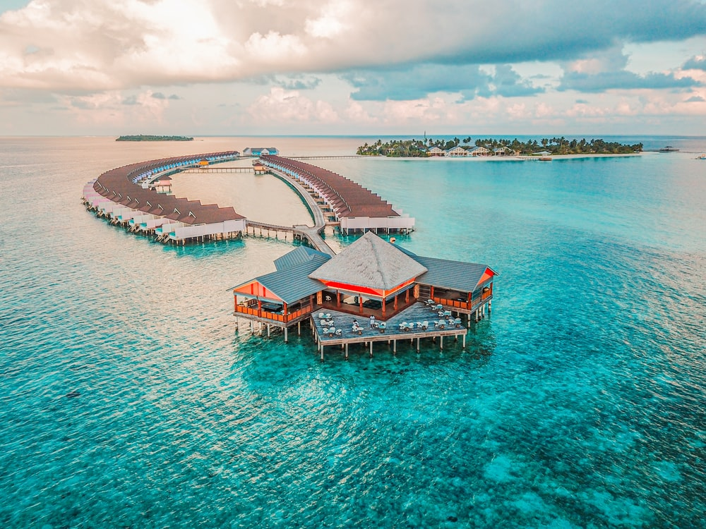 aerial photography of resort rooms and island