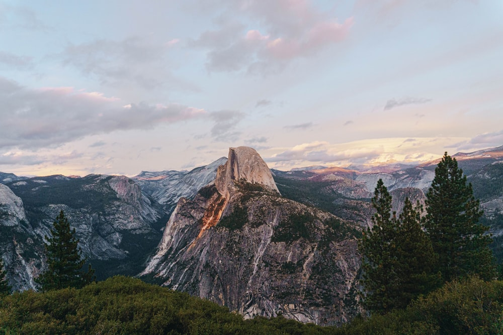 Yosemite National Park, Half Dome under blue and white sky