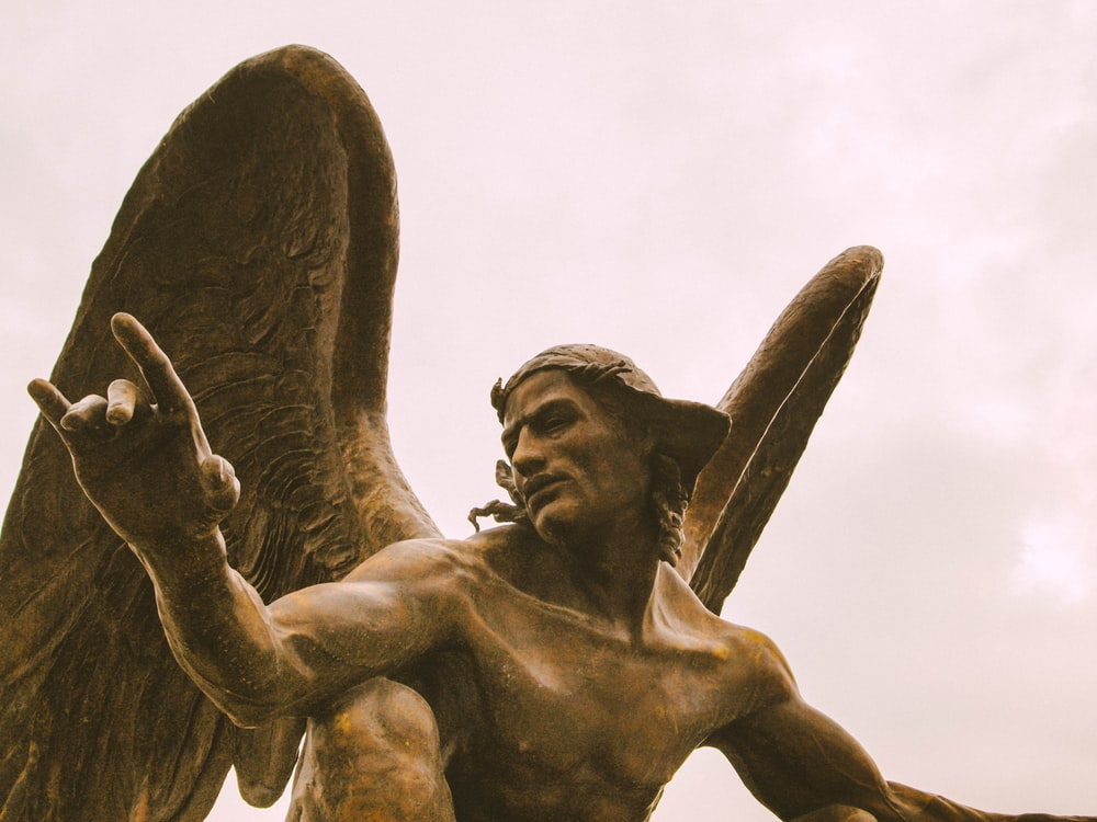 man with angel wing concrete statue