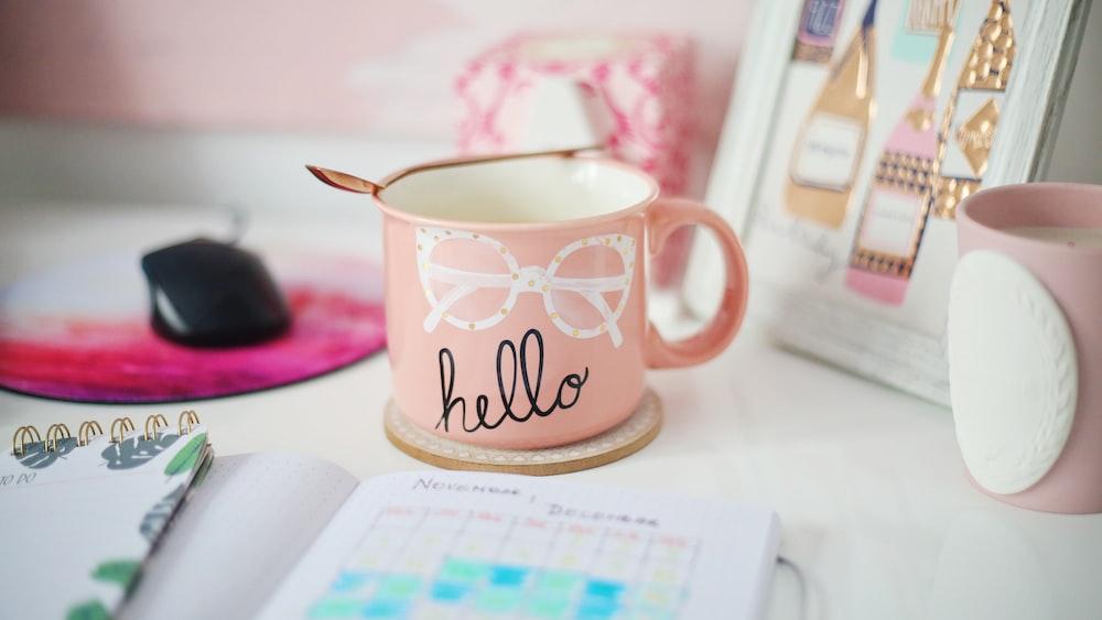 pink, white, and black Hello mug