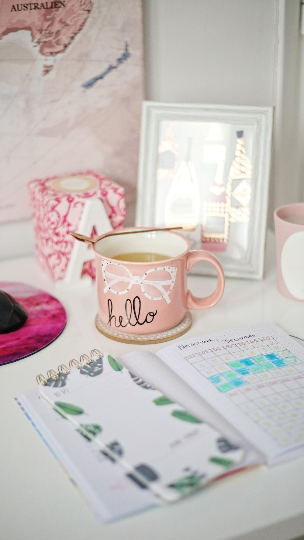 pink and white Hello ceramic mug
