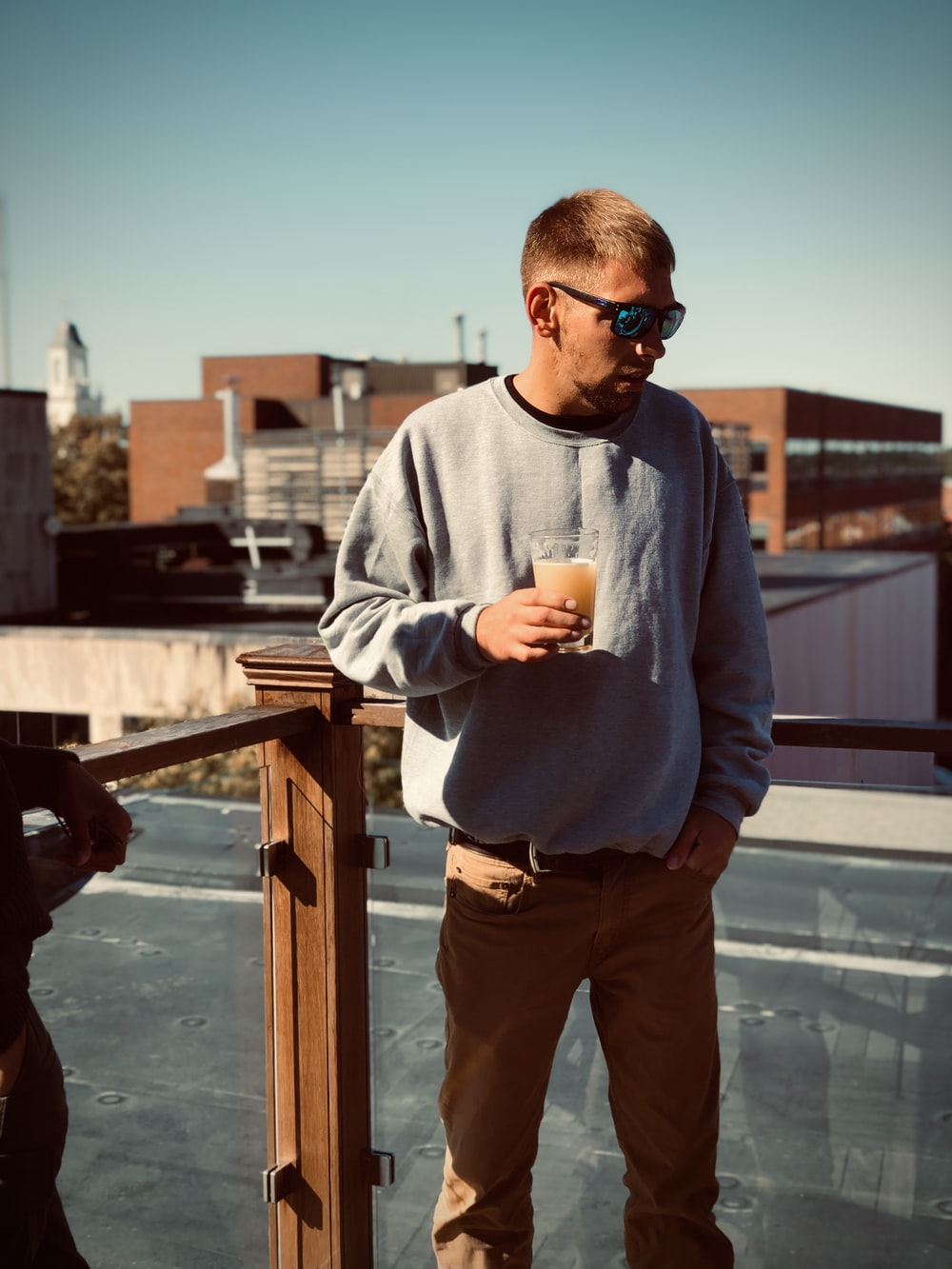 man standing and holding drink