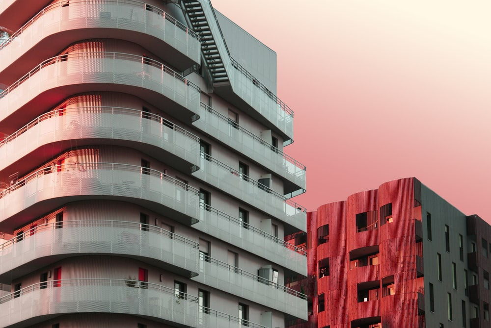 architectural photography of beige and red city buildings