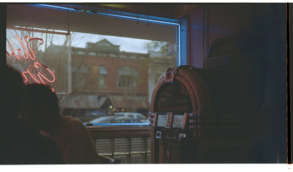 jukebox beside person indoors
