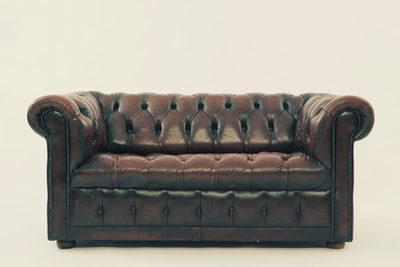 brown leather chesterfield sofa furniture teams background