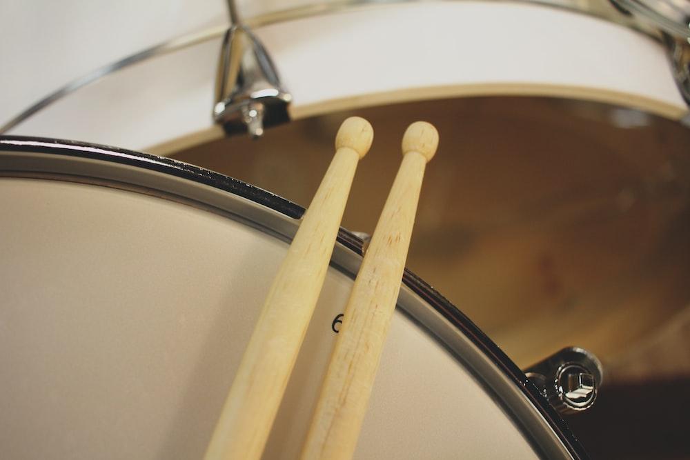 two beige drum sticks