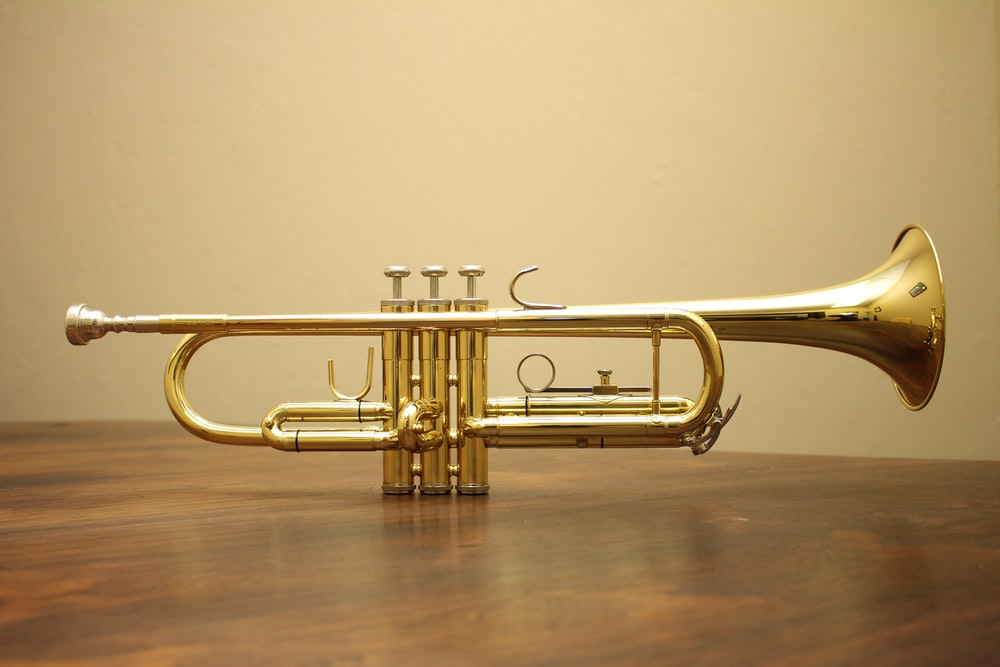 brass-colored trumpet
