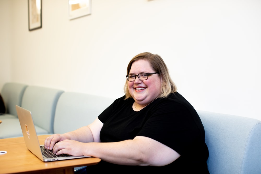 woman siting on sofa infront of laptop
