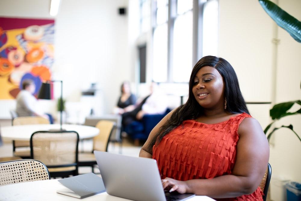 woman using laptop computer inside building