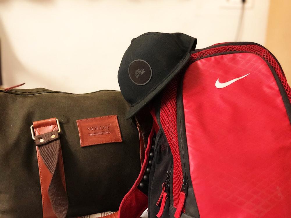 black cap on duffle bags