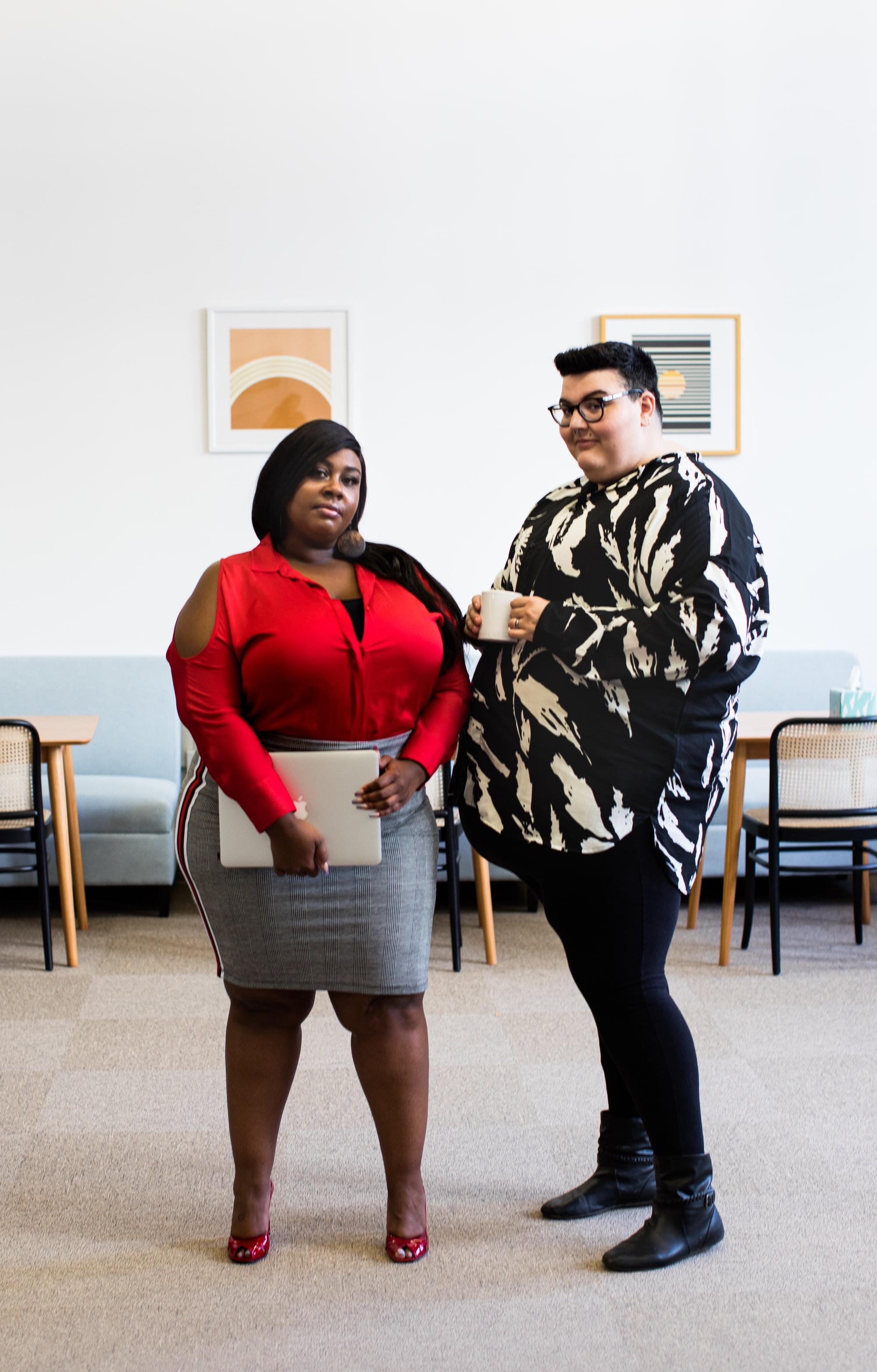 Group of plus size employees in a modern, bright open office