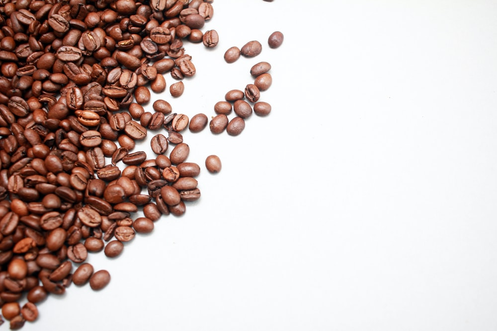 bunch of coffee beans on white background