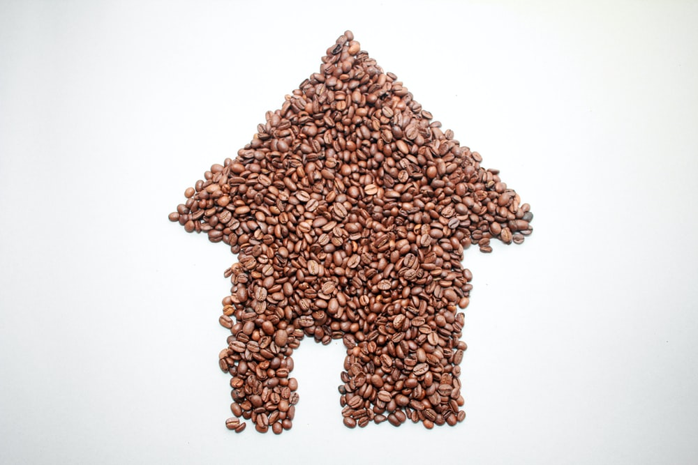 house-shaped brown coffee beans