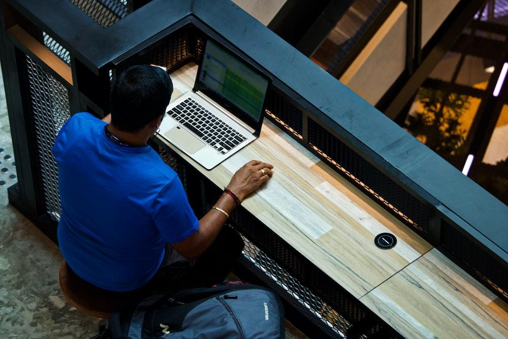 man using laptop on desk