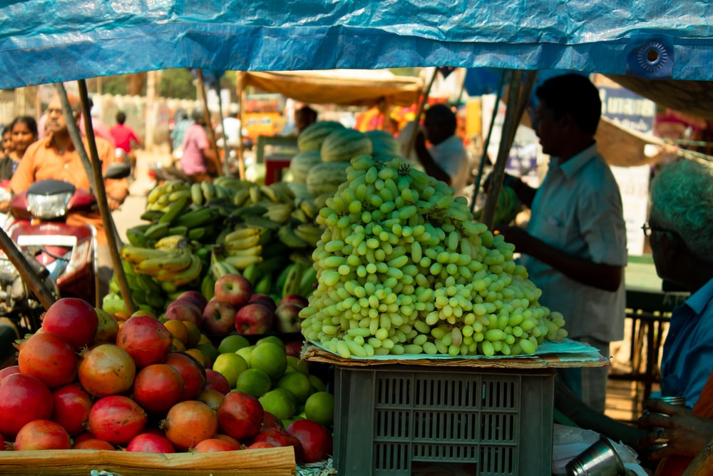 man selling fruits and vegetables