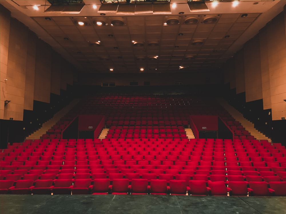 landscape photography of red seats inside a theater