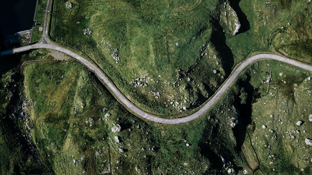 aerial photography of gray spiral road during daytime