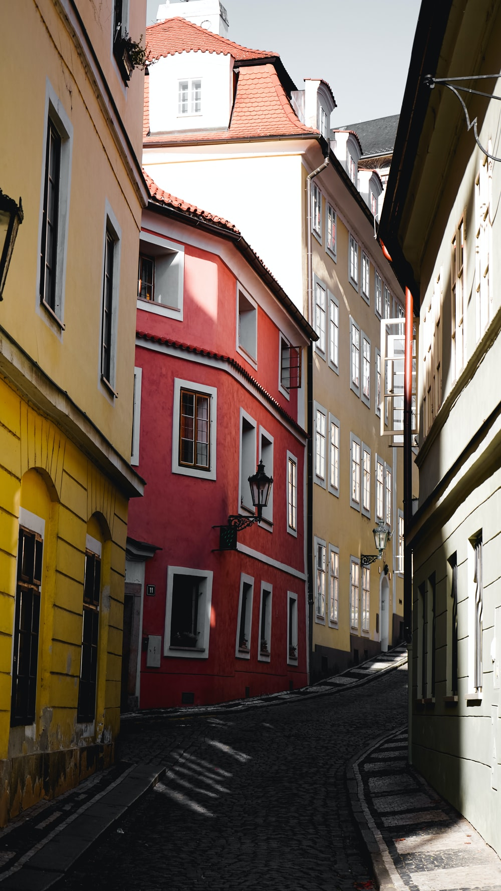 white, red, and yellow concrete buildings