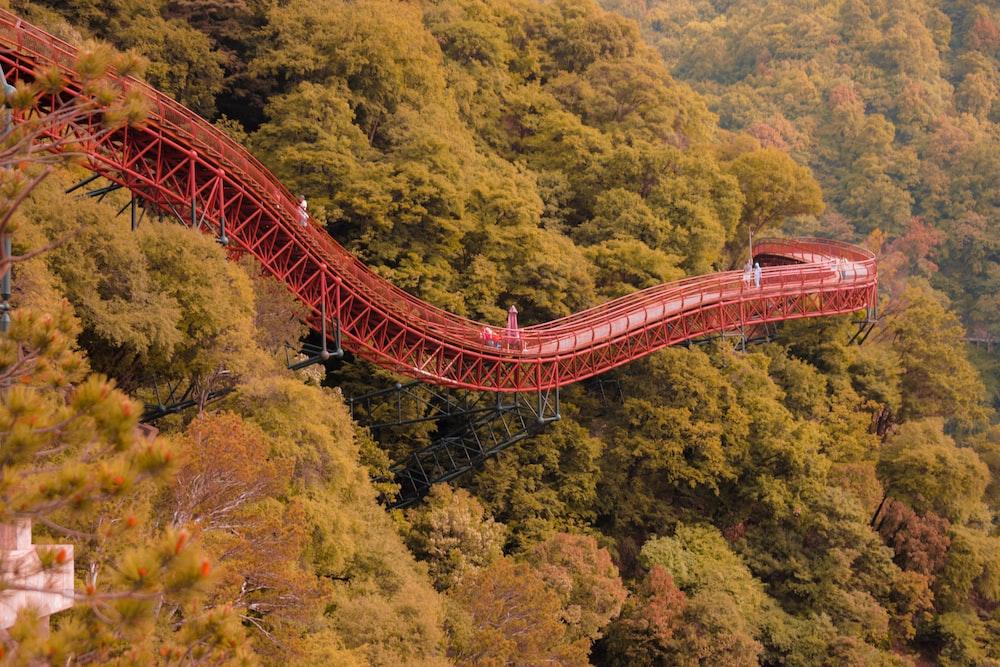 red steel bridge on mountain