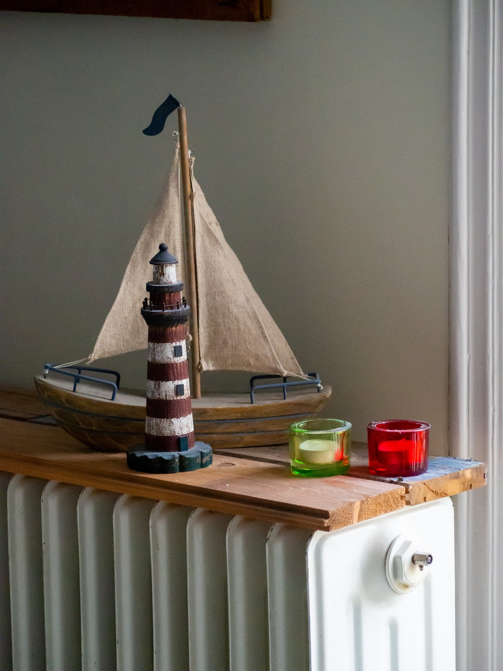 white and brown lighthouse miniature