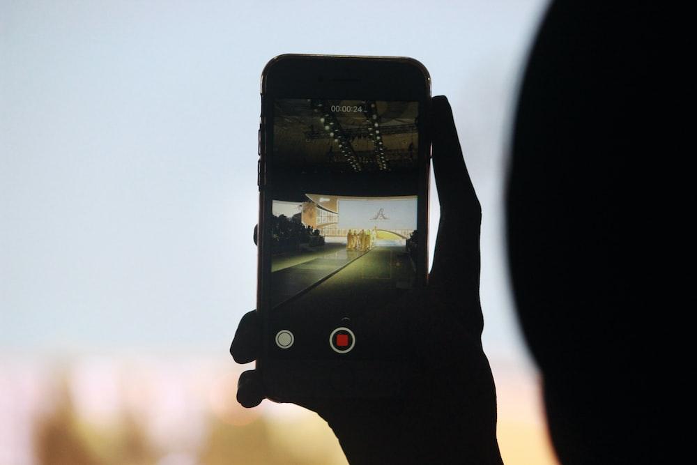 person using smartphone camera