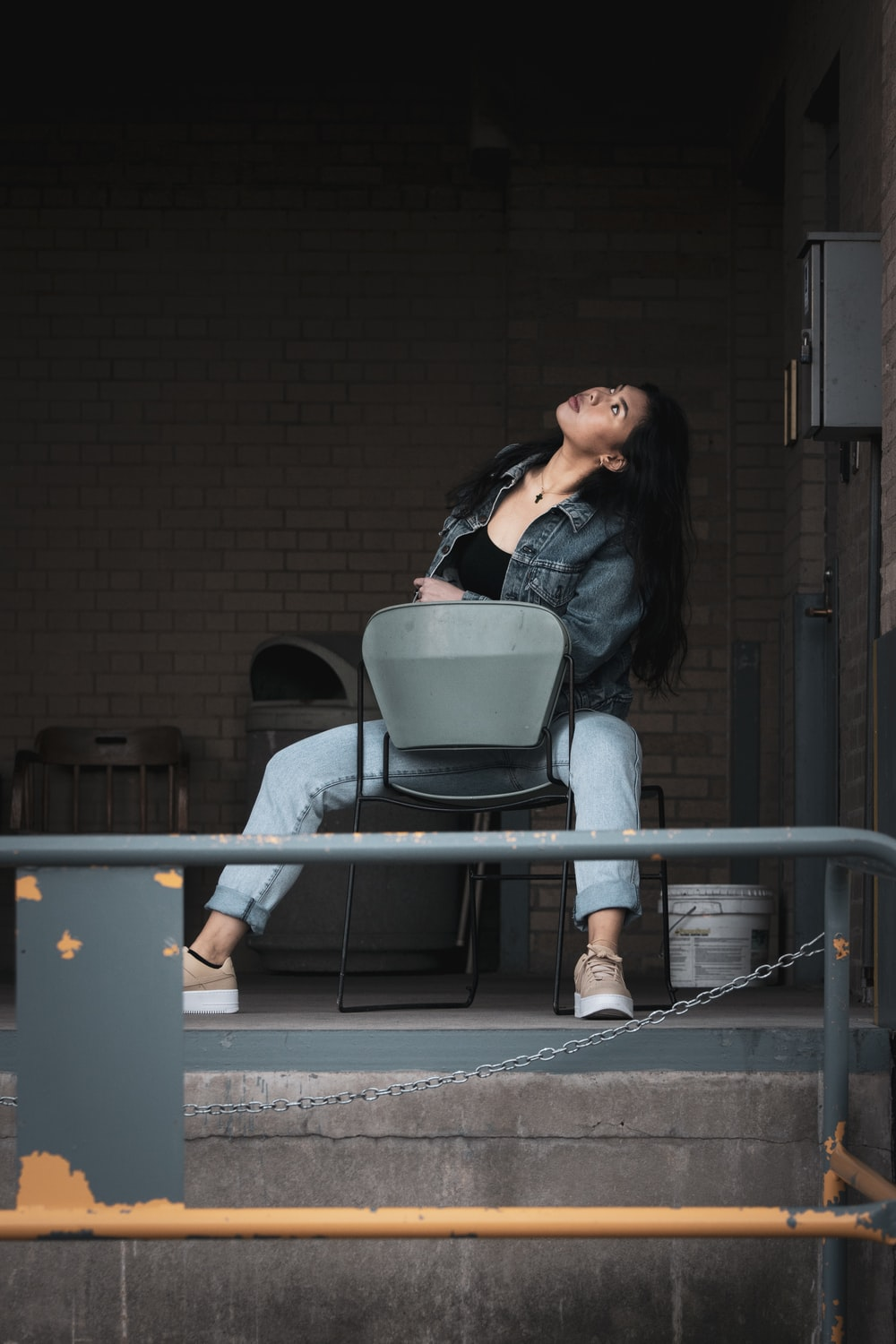 woman sitting on padded chair