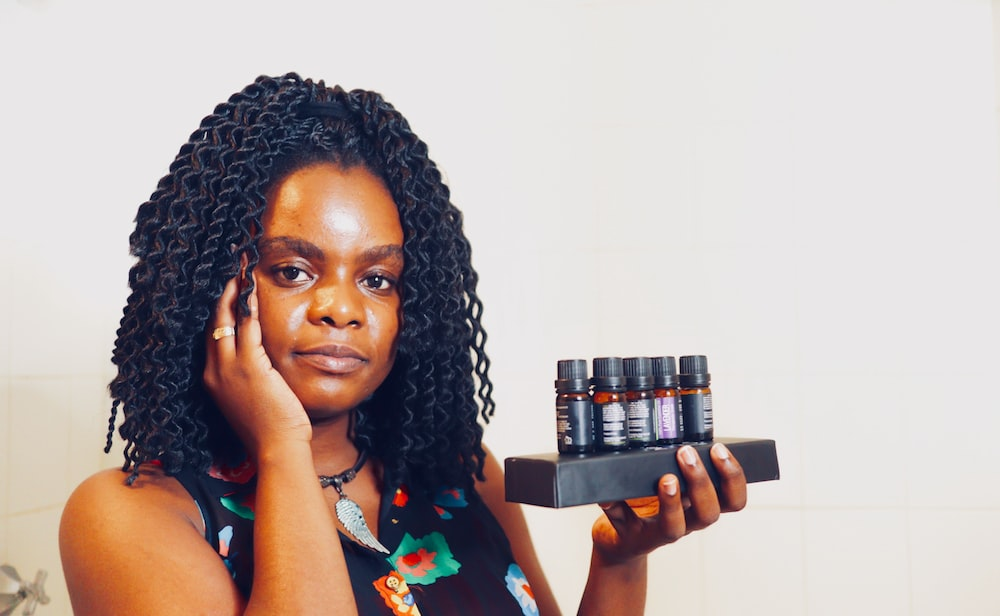 woman holding variety of oils