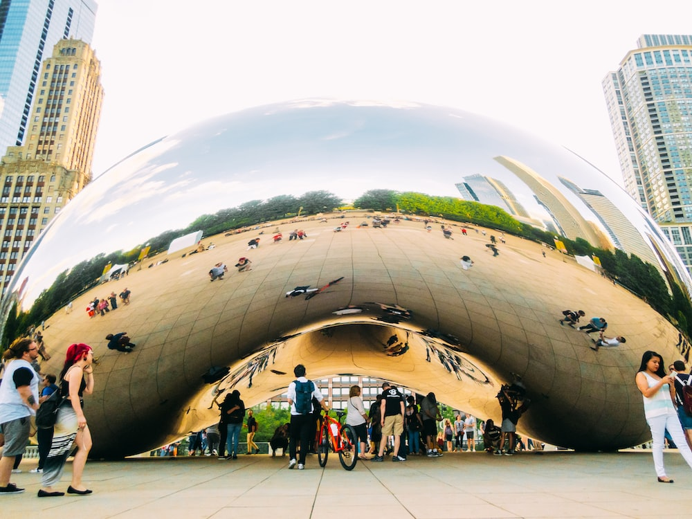 crowd walking beside Cloudgate, Chicago during daytime
