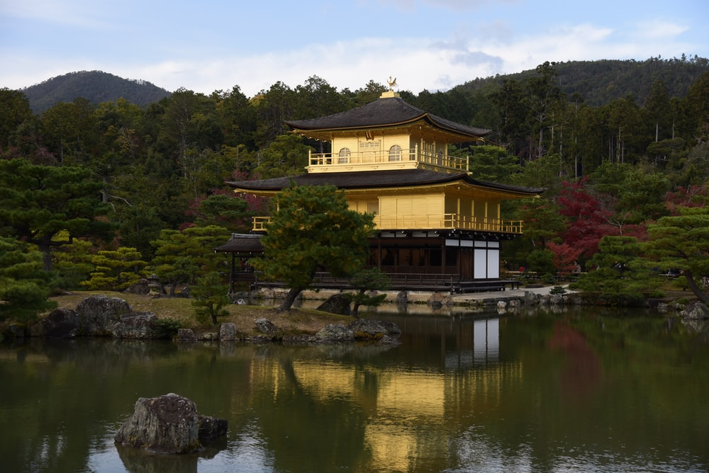yellow and black concrete house beside body of water