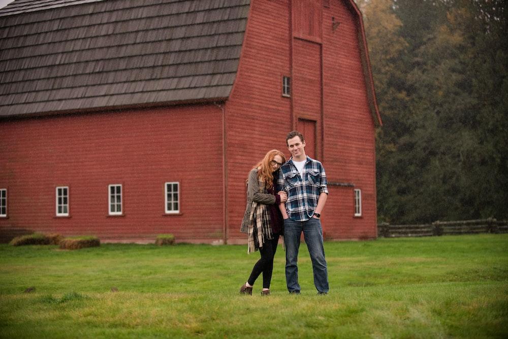 man and woman near barn