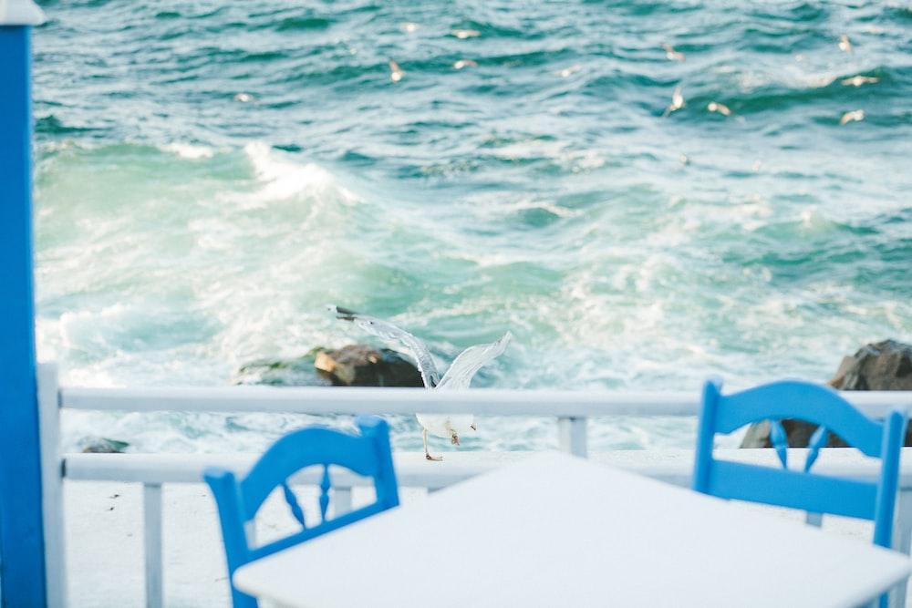 dinette set beside railing near body of water