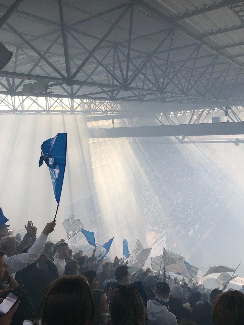 man waving the blue flag