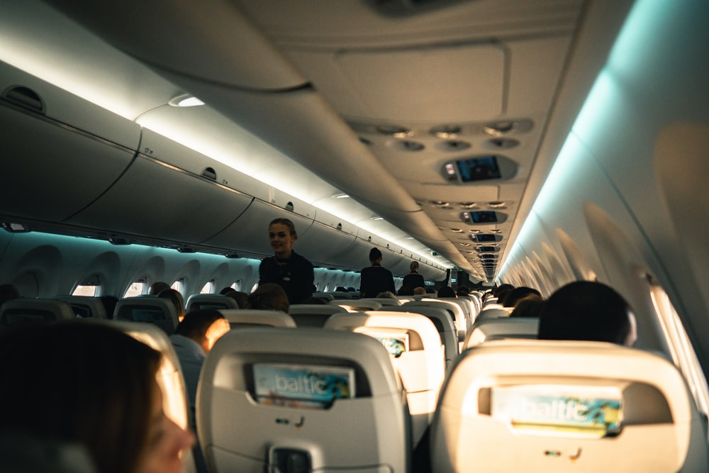 woman standing inside the plane