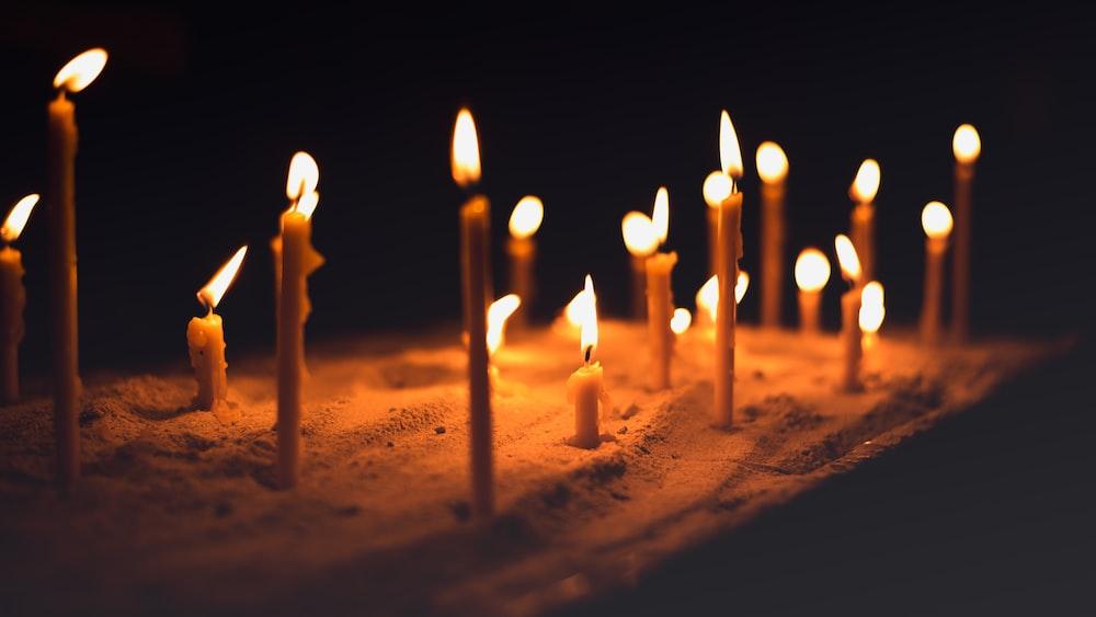 lit candle sticks