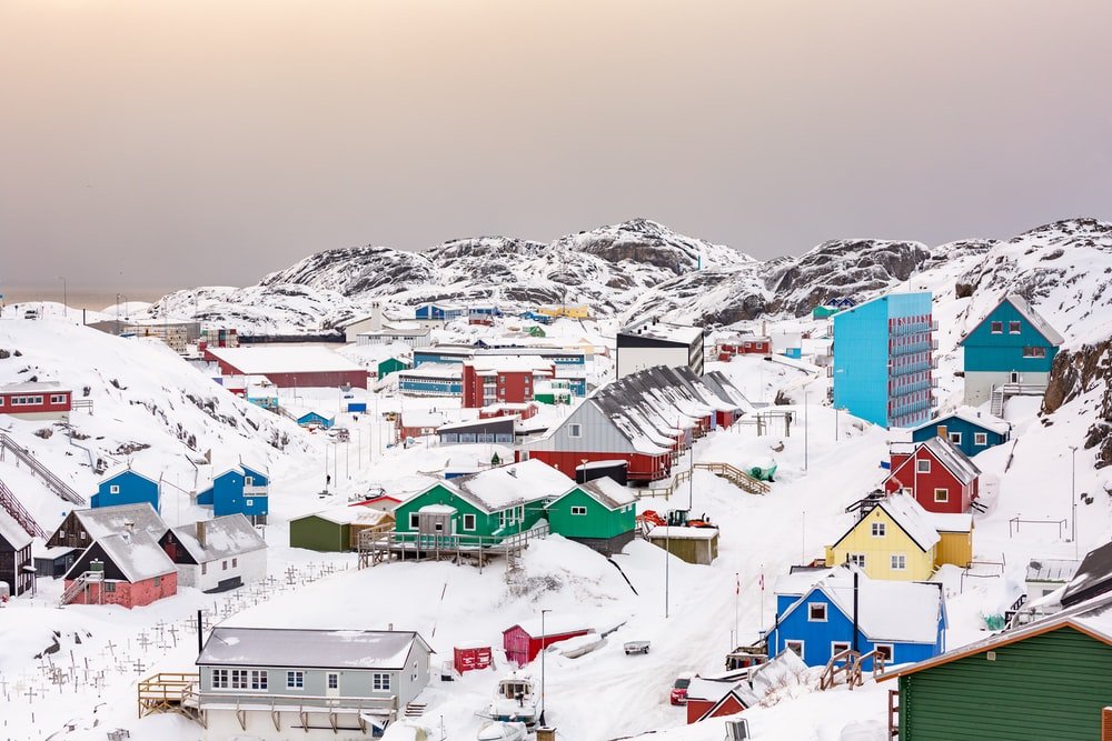 town on hill covered with snow