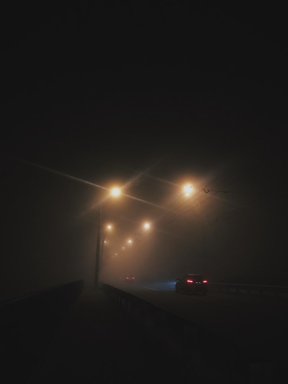 cars on road during a foggy weather