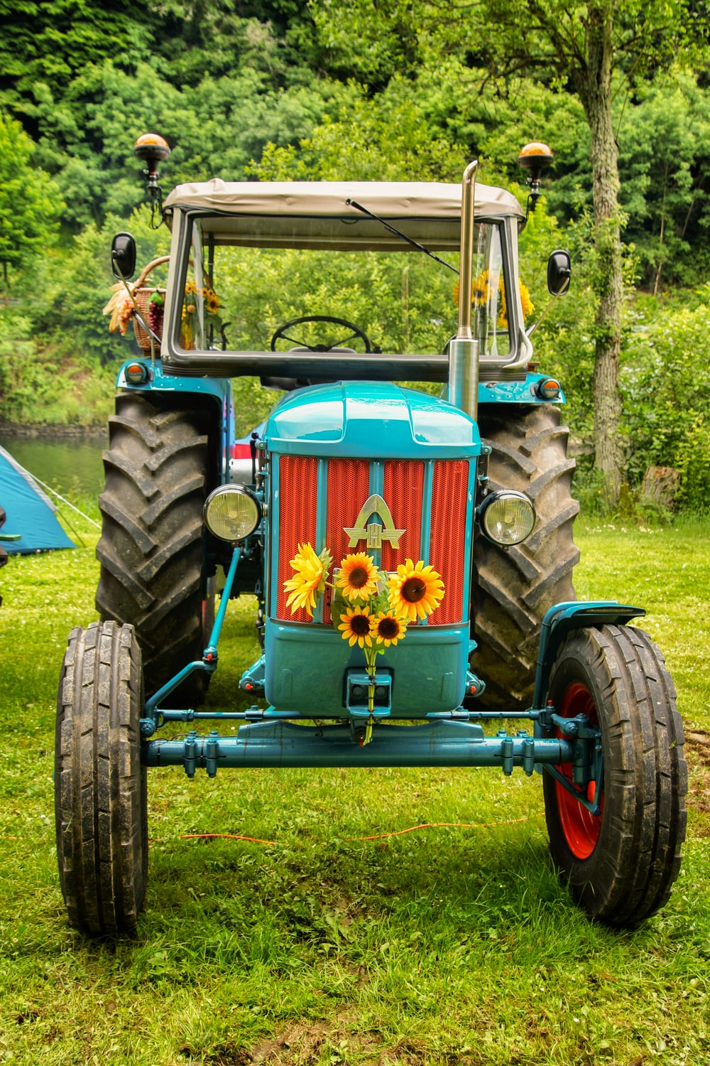 teal and white tractor
